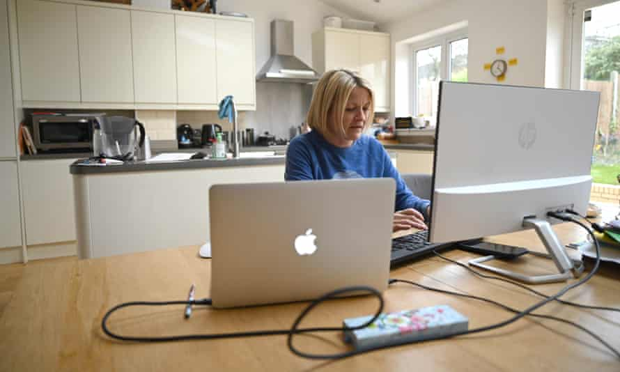 Woman working from home in a kitchen
