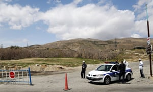 Security forces are seen at the entrance of a closed national park yesterday.