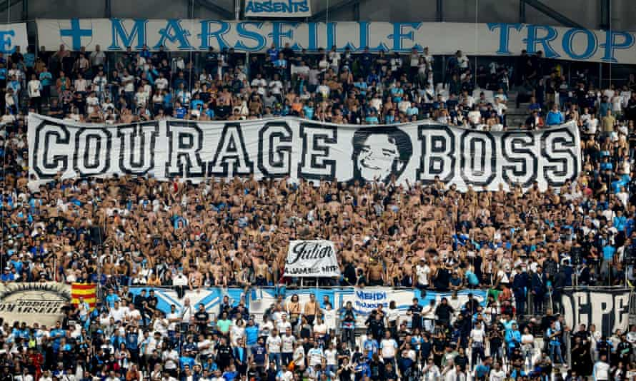 Marseille fans show their support for former club president Tapie during a Europa League match against Galatasaray last week.