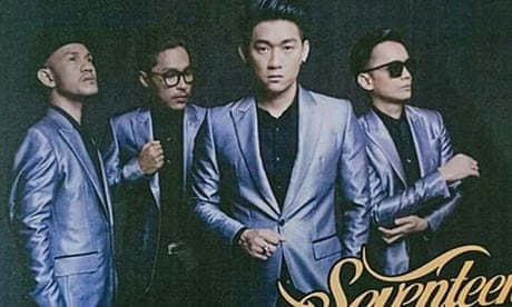 Wave crashes into stage at Indonesian pop band concert – video