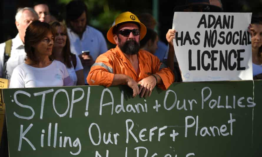 Environmental activists voice their opposition to Adani's proposed Carmichael coalmine.