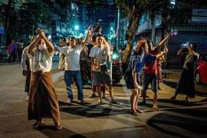 People take part in a noise campaign in Yangon after calls for protest went out on social media