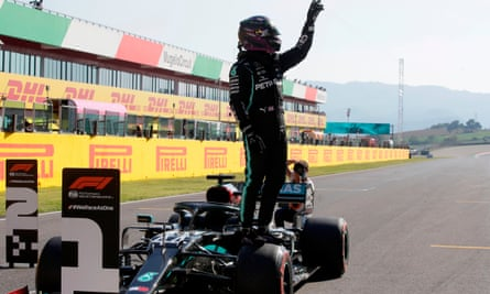 Lewis Hamilton celebrates after sealing pole position after the qualifying session at the Mugello circuit