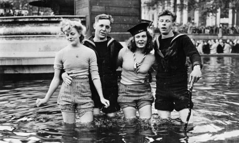 Joyce Digney and Cynthia Covello celebrating VE Day with sailors in a fountain in Trafalgar Square on May 8 1945.