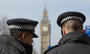 Two Metropolitan police Officers near Big Ben.