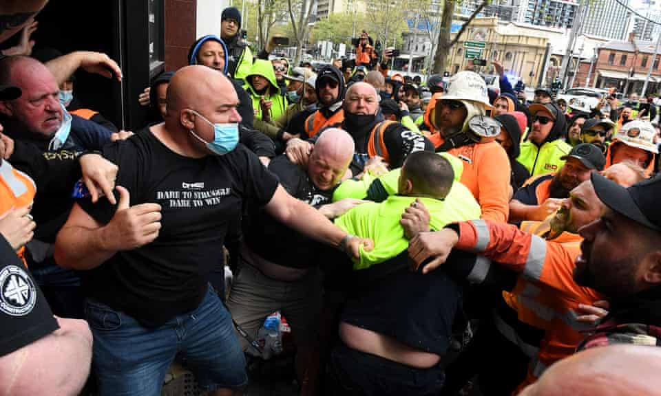 Construction workers clash with unionists at a protest at CFMEU headquarters in Melbourne over vaccine mandates.