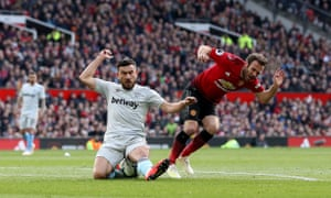 Manchester United's Juan Mata is fouled in the penalty area by West Ham United's Robert Snodgrass.