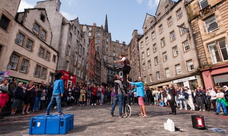 A street artist performs during a pre-pandemic Edinburgh fringe festival. The city is normally crowded throughout the summer.