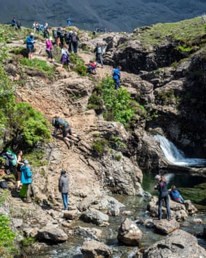 A large number of tourists at the fairy pools