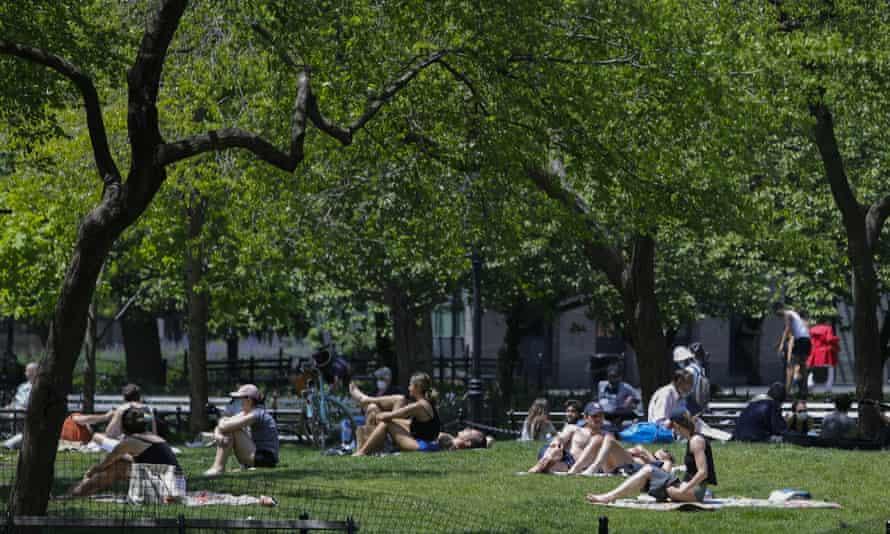 People enjoy warm weather during the coronavirus pandemic in Washington Square Park, 15 May 2020, New York.