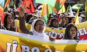Syrian Kurdish women carry banners as they demonstrate against Turkish threats in north-eastern Syria, on 7 October.