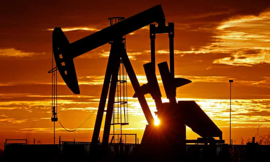 Pump jacks operate in the oilfields near Midland, Texas, at sunrise