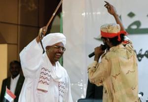 President President Omar al-Bashir dances with Mahmoud Abdelaziz in Khartoum on 12 April 2012.