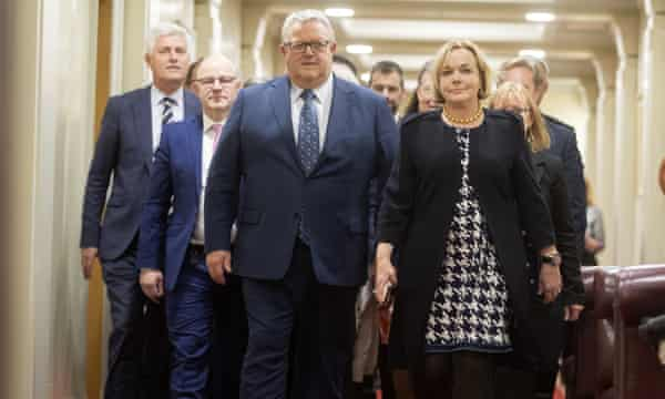 Judith Collins walks with the National party's new deputy leader, Gerry Brownlee, after a vote at parliament in Wellington.
