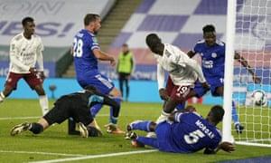 Leicester's Christian Fuchs (center left) scores an own goal against Arsenal