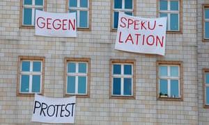Tenants hang banners out of their windows reading: 'Against speculation – protest'