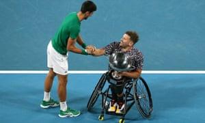 Dylan Alcott is congratulated by Novak Djokovic