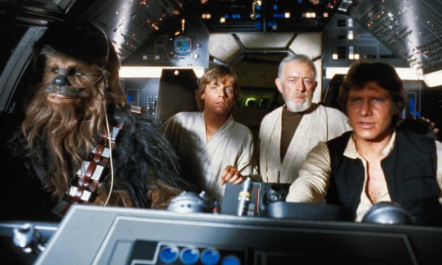 (Left-right) Peter Mayhew, Mark Hamill, Alec Guinness and Harrison Ford in Star Wars (1977).