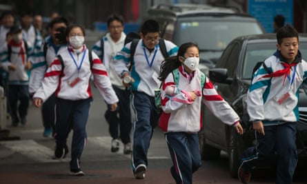 Children wear protective masks during a polluted day in Beijing, China.