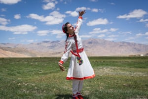 In the Pamir Mountains near Bulunkul village, eastern Tajikistan a young dancer performing as part of an event to promote tourism in this remote and beautiful region.