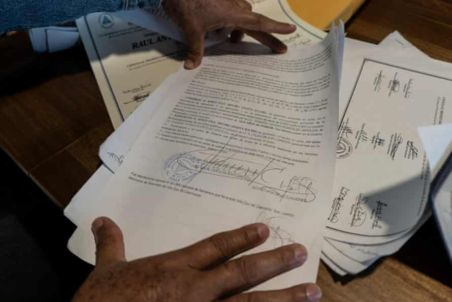 San Jose, Costa Rica. January 22, 2019 Raul Oporta showing the original court documents that sentenced him to two years in prison.