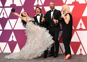 Elizabeth Chai Vasarhelyi, Jimmy Chin, Evan Hayes and Shannon Dill celebrate winning for Best Documentary Feature - Free Solo