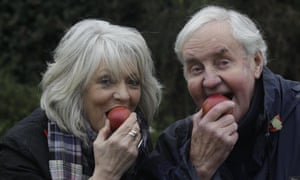 Alison Steadman and Richard Briers from the Good Life eat apples at a photocall for the orchard