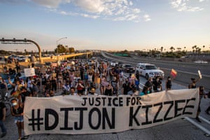 Protesters march on the 110 freeway in Los Angeles in protest over the shooting of Dijon Kizee.