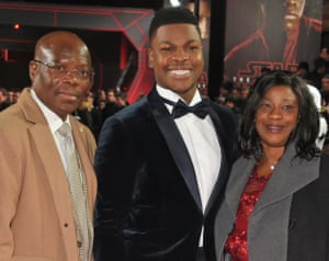 Actor John Boyega with his parents at the London premiere of Star Wars: The Last Jedi in December 2017