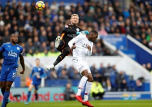Crystal Palace's Christian Benteke collides with Leicester City's Kasper Schmeichel.
