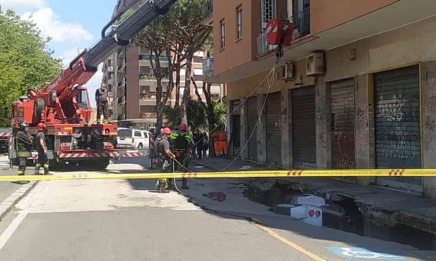 Emergency services at the scene of the sinkhole in Via Zenodossio, in the Torpignattara district of Rome
