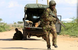 A Kenya Defence Force soldier runs for cover during al-Shabaab's Garissa attack in April. The group is suspected of carrying out another atrocity in a village near the Somalia border.<br>