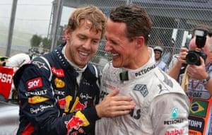 Sebastian Vettel is congratulated on his title by Michael Schumacher.