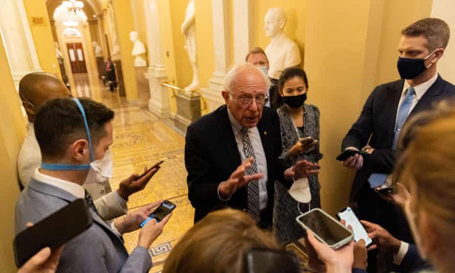 Senator Bernie Sanders talks to reporters on Thursday as infrastructure negations continue in Washington DC.