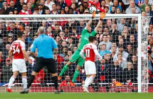 Cech tips the free-kick over.