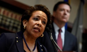 US attorney general Loretta Lynch speaks while standing with FBI director James Comey, during a press conference about the Fifa arrests.