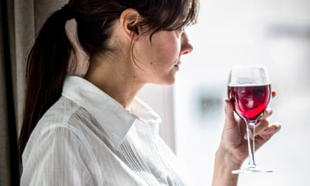 Woman holds a glass of wine