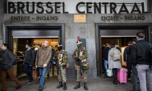 Soldiers stand guard at the entrance of Brussels' central station
