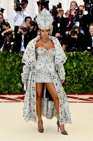 All hail the pope. After arriving in her own pope-mobile, Rihanna had her own take on papal style with her custom designed Maison Margiela gown.