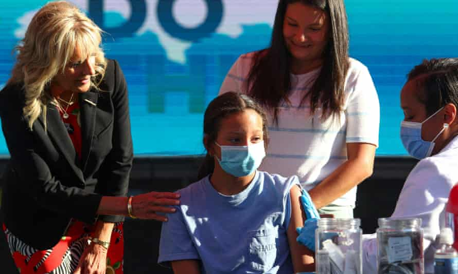 First lady Jill Biden comforts Adriana Lyttle, 12, as she receives her vaccine in Nashville, Tennessee in June.