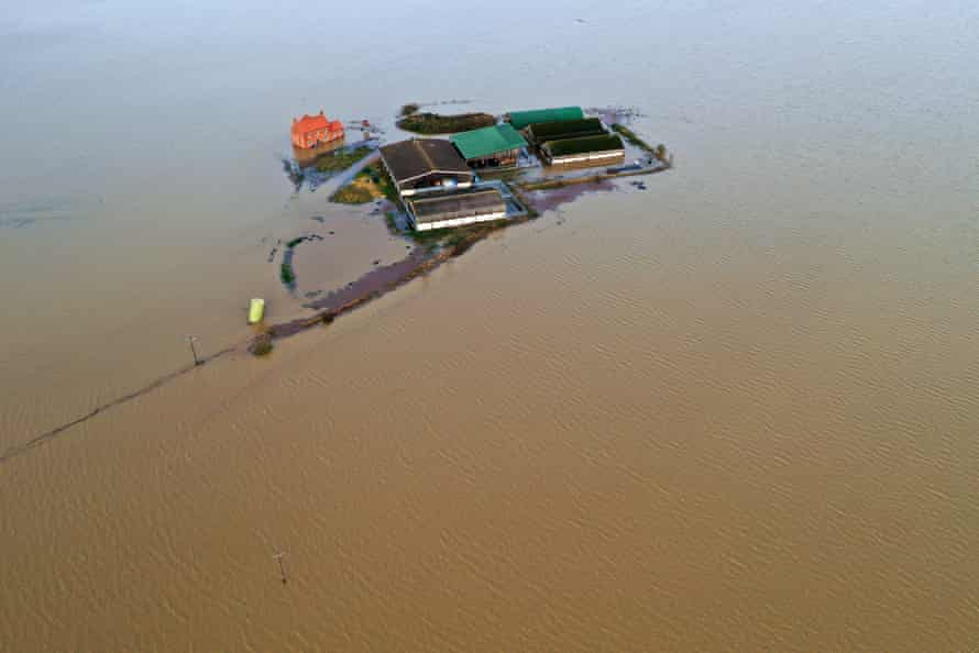A farm in Bardney, near Lincoln, is marooned by flood water after the Barlings Eau broke its banks.