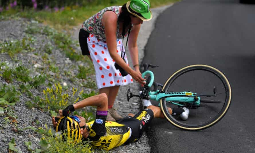 A fan comes to the aid of George Bennett of Team Jumbo-Visma after he crashed on Stage 18 between Embrun and Valloire.