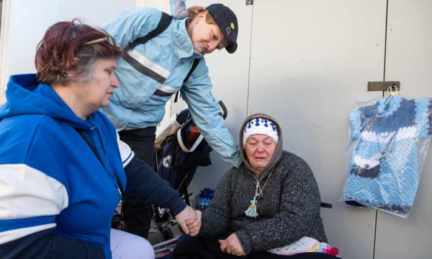 Kaz (right) cries as as she is comforted by Monica Gregory (left) and Jackie Keating as she remembers her homeless friend Sharron Maasz who died on the streets of Oxford.