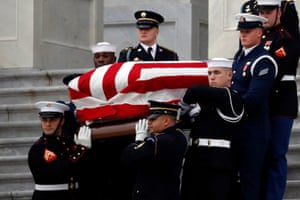 A joint services military honour guard carries the flag-draped casket of former USpresident George HW Bush from the US Capitol to transport it to Washington National Cathedral.