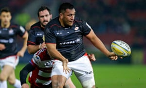 England's Mako Vunipola offloads out the tackle