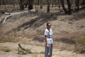 Vanessa Hickey standing next to the empty Barwon. She remembers jumping into the river as a child