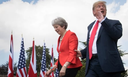 Donald Trump and Theresa May at Chequers, with union jacks and stars and stripes in background