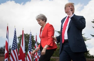 Donald Trump walks with Theresa May before a joint press conference at Chequers.