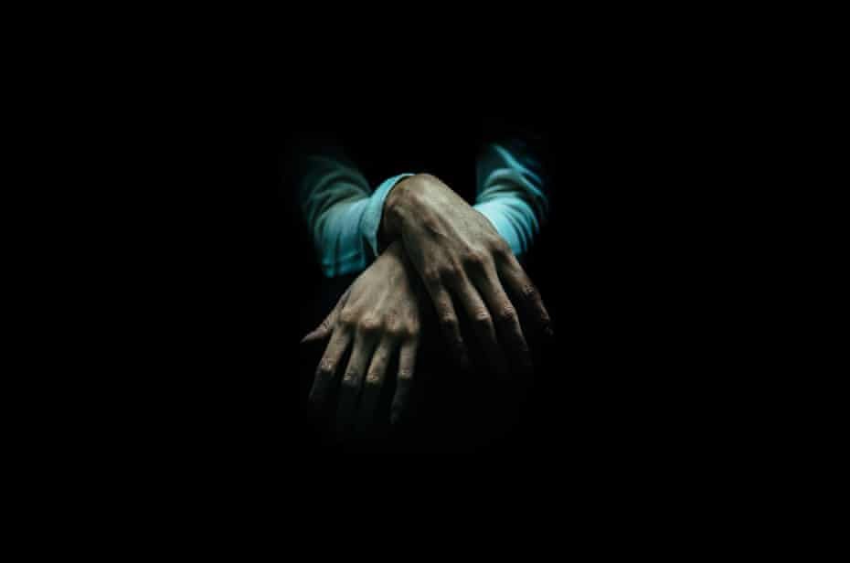 Close-up of hands over a black background