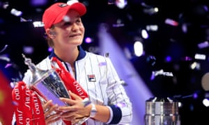 Ashleigh Barty poses with the Billie Jean King Trophy after her victory in Shenzhen.